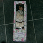 unknown maker 186Porcelain Doll  unused in box called Natalie (black) very cheap to clear!
